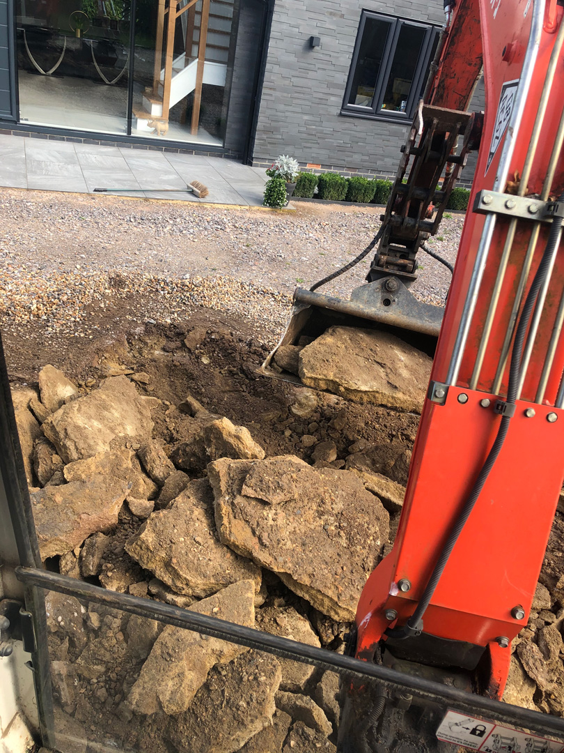 Digger hire small job digging out concrete in Hurst