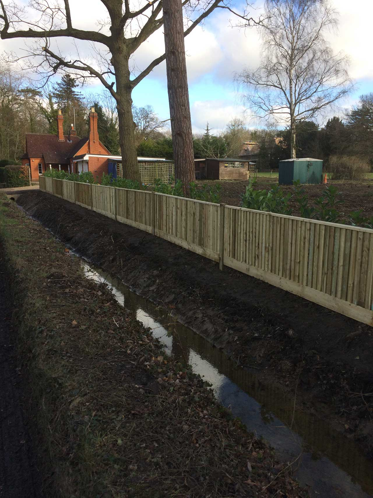 Image of a ditch after cleaning - Digger hire and excavator hire in Berkshire, Hampshire and Surrey - ditch after cleaning - Ditching, drainage and flood minimisation - Berkshire, Hampshire and Surrey.