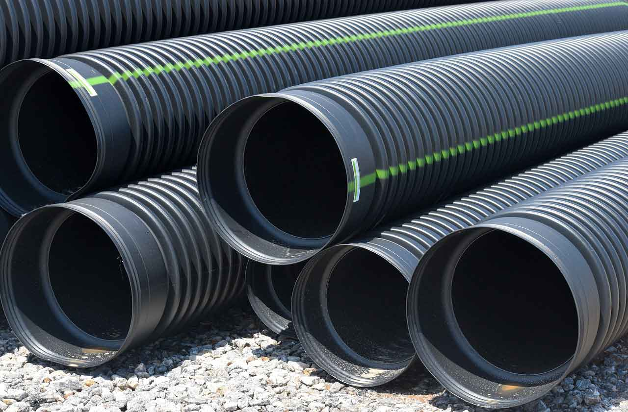 Image of Drainage pipes in Berkshire and Surrey - Let the digger do it, flood prevention in Berkshire and Surrey.