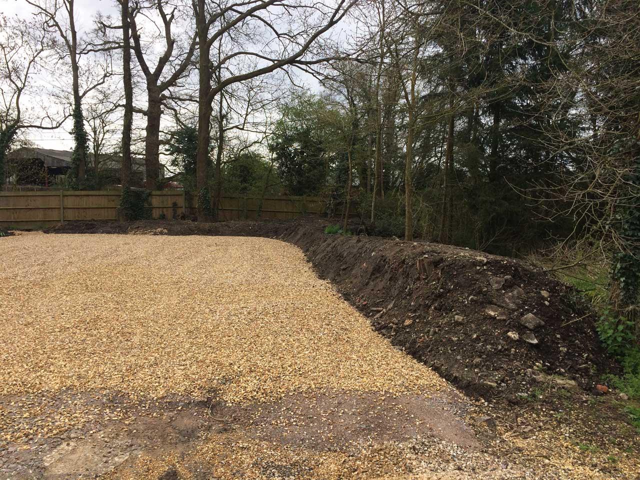 Image of Earthworks - Earth Berm - Berkshire Hampshire Surrey - Car park driveway construction Holme Grange School Wokingham Berkshire - Let the Digger Do It