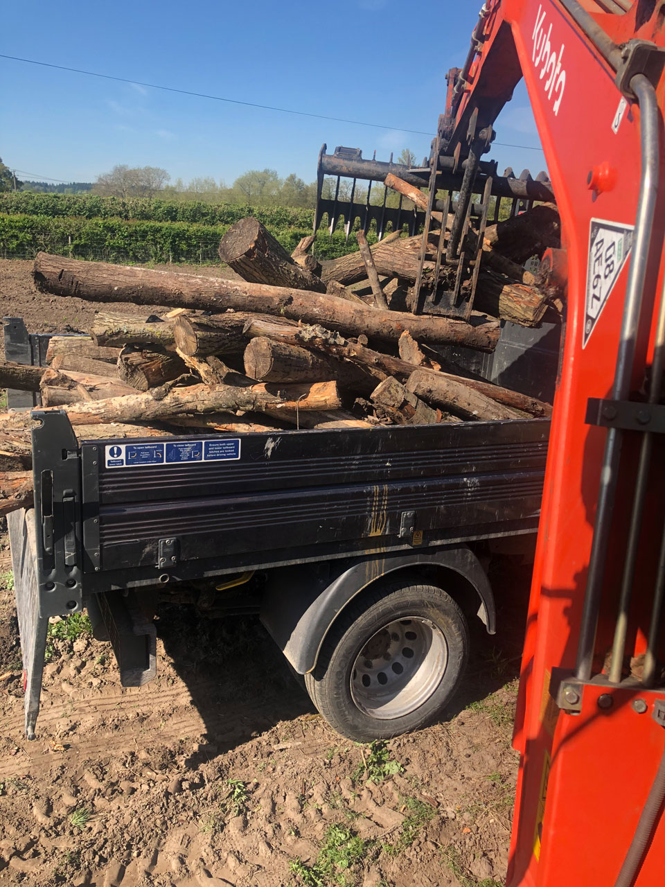Excavator hire with driver Wokingham Berkshire Hampshire Surrey excavator hire with grab loading logs