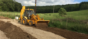 Excavation and Grading Berkshire Hampshire Surrey - digger hire with driver for grading and levelling in Berkshire Hampshire and Surrey