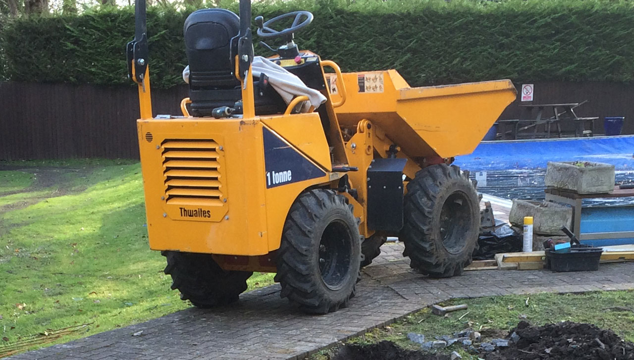 Image of a skip loader working at Holme Grange School in Wokingham Berkshire. Let The Digger Do It carrying out earthworks and concrete works at Holme Grange School Wokingham. Berkshire digger hire - Let The Digger Do It - skip loader Berkshire.