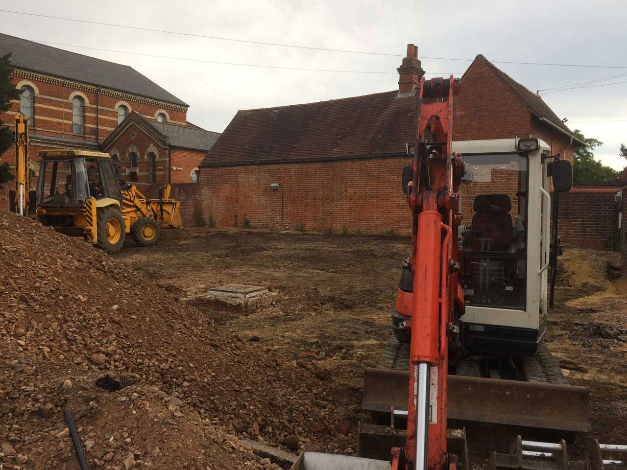 Levelling ground for a carpark in Wokingham Berkshire - digger hire with a driver for levelling ground Berkshire Hampshire