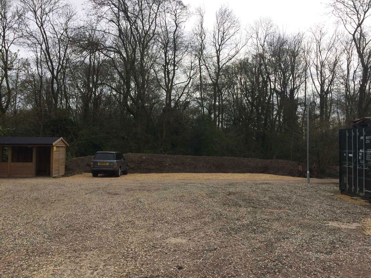 Levelling ground to make a carpark in Wokingham Berkshire - digger hire with a driver levelling Berkshire Hampshire Surrey
