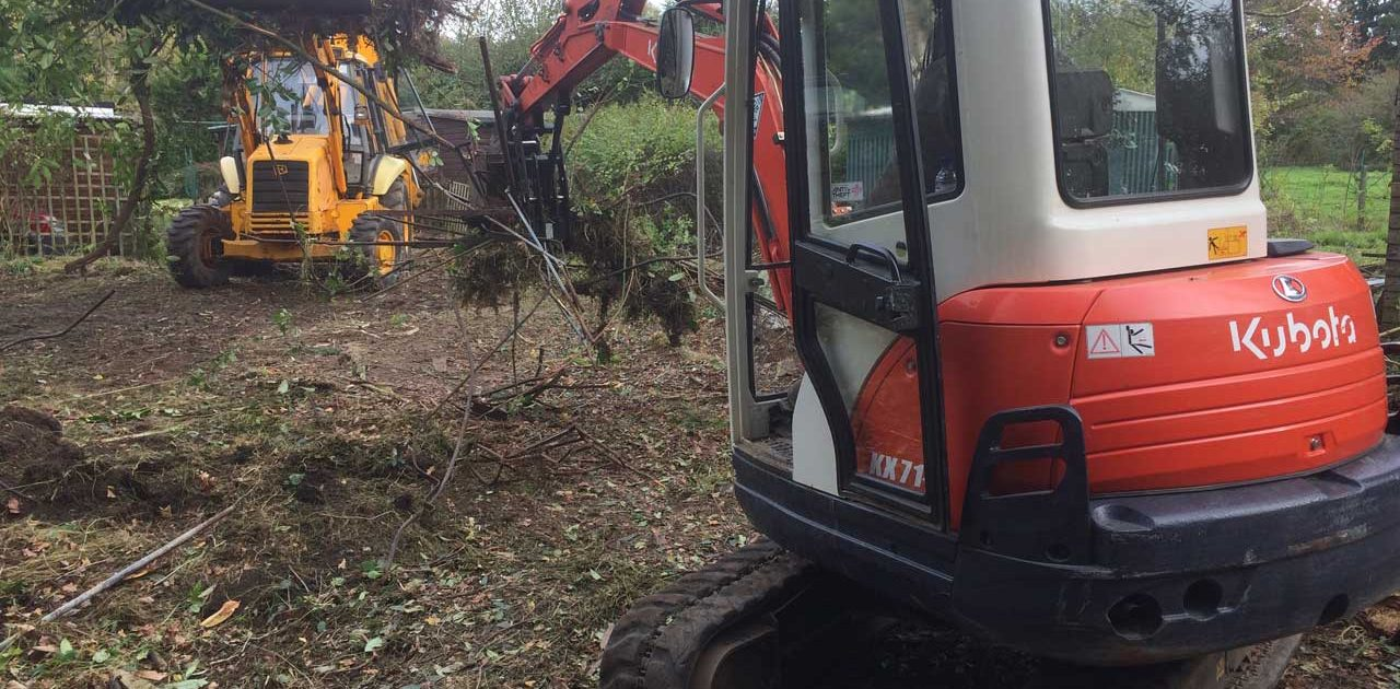 Image of a Kubota excavator and a JCB clearing land in Ascot, Berkshire - Land clearance in Ascot, Berkshire preparing for seeding - land clearing by kubota and JCB in Ascot, Berkshire - Let the digger do it!