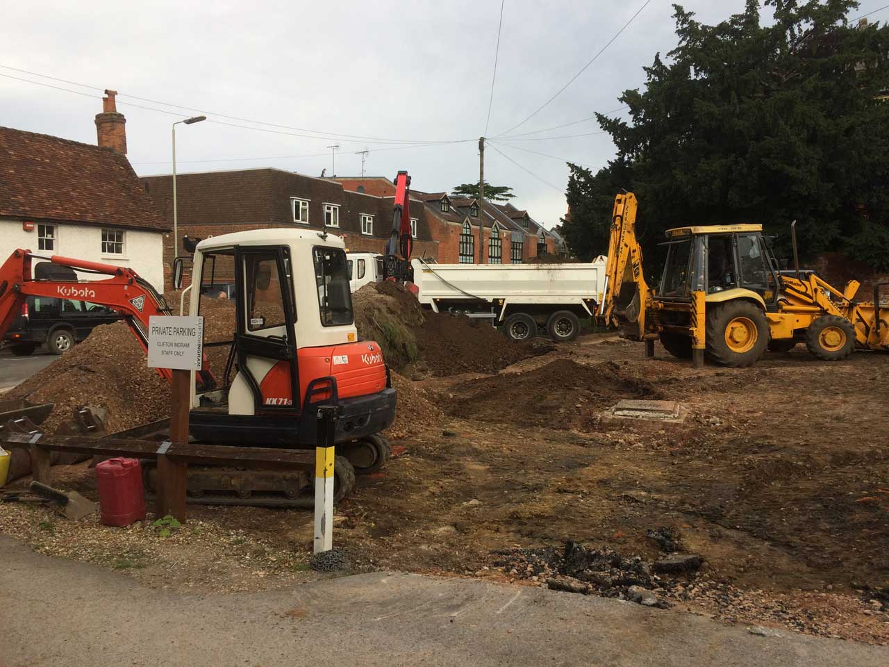 Image of a reduction dig for the construction of a new carpark in Wokingham, Berkshire. Digger hire and excavator hire in Berkshire, Hampshire and Surrey.
