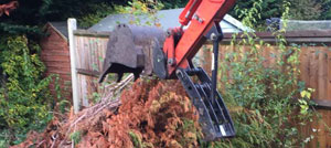 Remove old fence posts with a digger - remove old concrete fence posts - man and machine hire Berkshire Hampshire Surrey - pulling out old fence posts