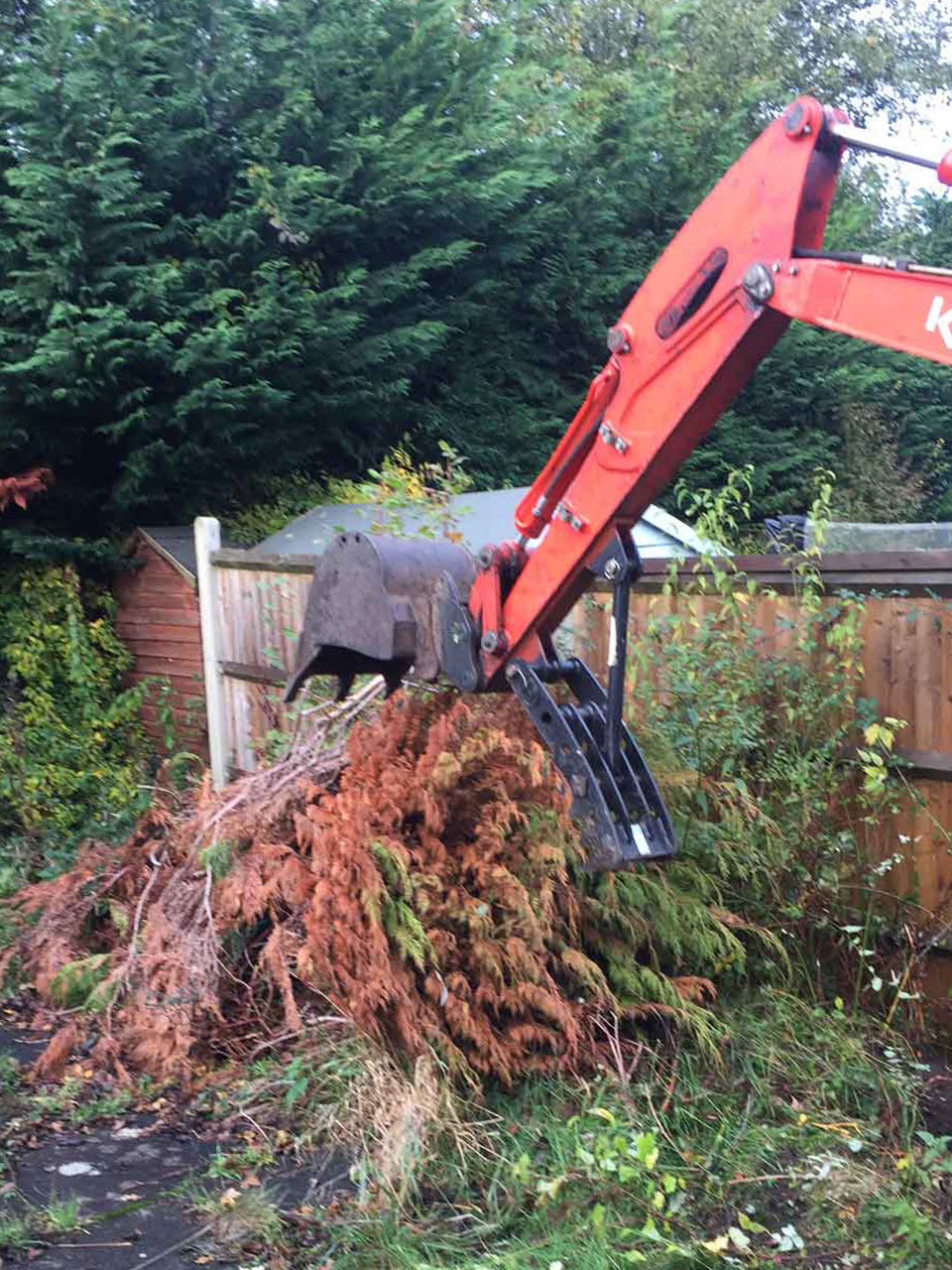 Remove old fence posts with a digger - remove old concrete fence posts - man and machine hire Berkshire Hampshire Surrey