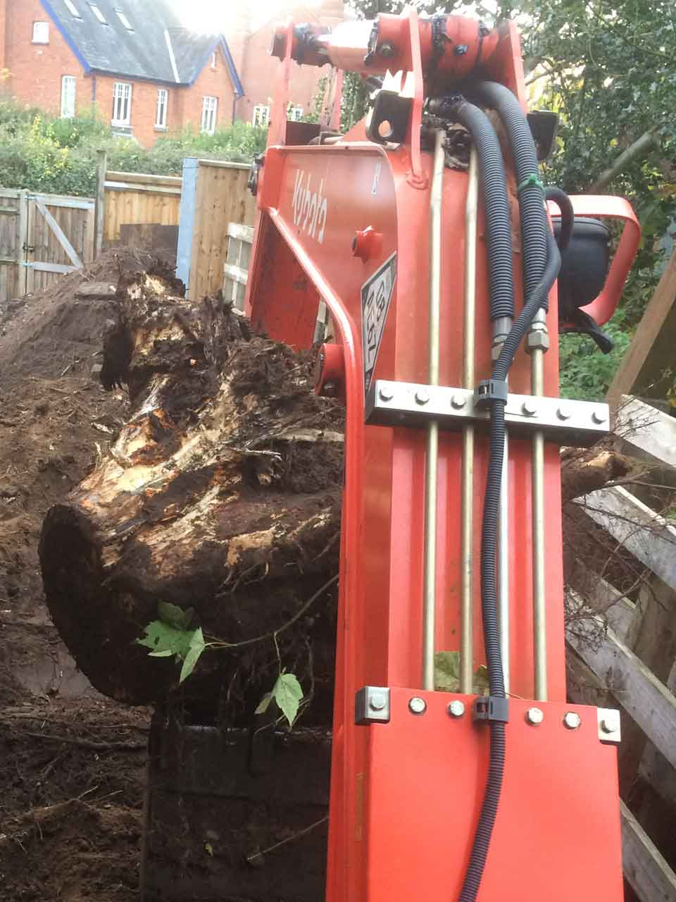 Image of tree stump removal in Wokingham, Berkshire by excavator - Tree stump removal in Wokingham, Berkshire by excavator - Digging a Tree stump out in Wokingham, Berkshire - Let The Digger Do It!
